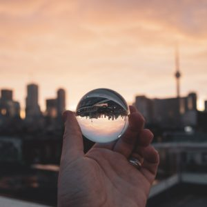 city through glass ball by thom bradle